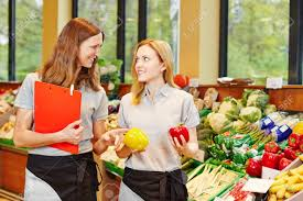 Store Manager In Supermarket Teaching Trainee In The Vegetables