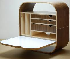 folding curving light brown wooden desk with shelves also drawers