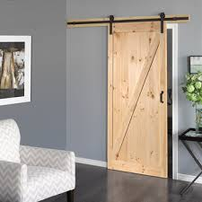 interior one panel knotty alder stained solid wood slab barn door with z brace