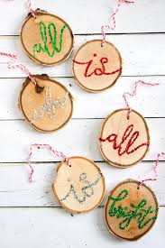 diy wooden ornaments handlettered with glittering s from silent night wood slice ornaments for