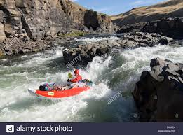 running tumwater falls on oregon s john day river in an inflatable  running tumwater falls on oregon s john day river in an inflatable kayak