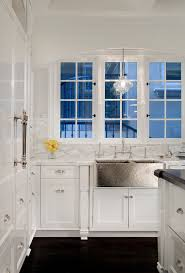 lighting kitchen sink kitchen traditional. kitchen sink lighting traditional with award winning bridge faucet