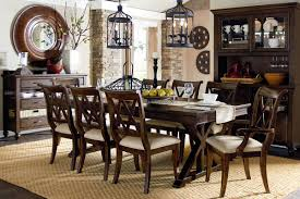 dining room small formal room yellow light copper chandelier brown circle antique glass roof table