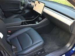 tesla model 3 model s driver s seats compared