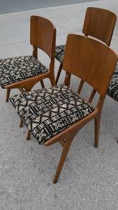 set of 4 mid century cantilevered teak dining chairs reupholstered with african mud cloth