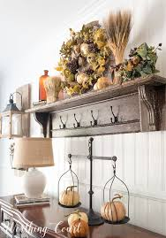 the top of a vintage mantel becomes a shelf when the legs are cut off