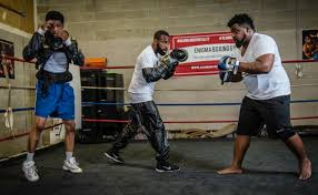 from left gary antonio russell gary russell jr and gary allan russell work out in the ring