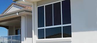 angular view of an aluminum window of a house with white frame