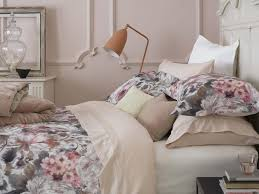 big bold fls can make a real statement of a bed and this one with its pink and brown tones does just that it comes from christy the homeware