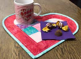 quick and easy to make with just a touch of applique a heart shaped mug rug is perfect for showing your love any day of the year