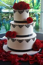 Picture Of A Black And White Wedding Cake Topped With Red Roses