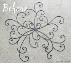 the easiest way to update metal wall decor give it a coat of paint and