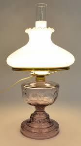 antique purple hurricane lamp with fenton milk glass ruffle top lamp shade