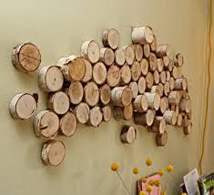 diy rustic wood logs wall art via shelterness
