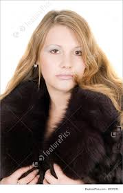 portrait of the beautiful young lady in a fur coat women in winter