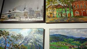 russia city lipin bor july 8 2016 showroom alexandra ilyina paintings by local artists painted oil hang on the wall of the exhibition hall stock footage
