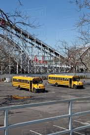two empty buses in an abandoned parking lot coney island usa