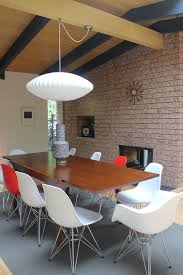 beautiful swag lamps in dining room modern with black ceiling next to double sided fireplace alongside light living room t46 light