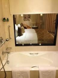 shangri la s eros hotel bathtub with a view of the bedroom