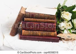 old books with flowers csp49398316