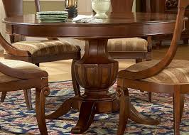 wood round dining table with chairs