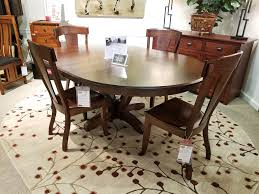 in view of the brookfield pedestal dining set made with solid cherry wood in a bourbon stain