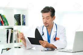 Doctor Reading Chart Asian Man Doctor Reading Chart
