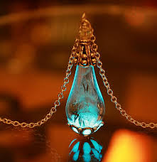 silver or gold tear drop pendant with dandelion seeds glow in the dark