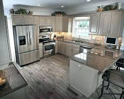 steel grey granite countertops with white cabinets and s