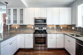 white kitchen cabinets gray countertops kitchen with dark tile floors small white galley kitchen ideas white