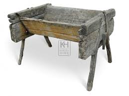 early rustic wood feed trough 1