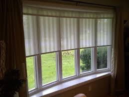 Bay windows can be a challenge when straight blinds need to round the  curve. Richard solved the problem by using 5 identical individual custom  blinds and ...