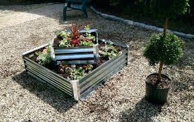 raised garden bed steel photo 2 diffe sizes of steel garden beds with flowers planted in