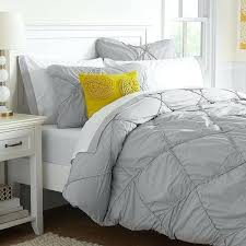 white bed blanket bed linen grey and white bed linen plain grey bedding free yellow pillow white bed
