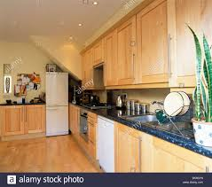Granite Kitchen Work Tops Pale Wood Fitted Units With Granite Worktops In Modern Kitchen
