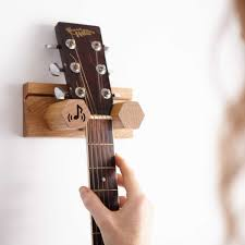 wall mounted guitar and plectrum stand