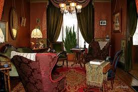 Example of a Victorian Room: Dark Furnishings, Oriental Rugs, Collections  of Items, and much more to come in the future in my postings.