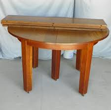stickley round mission oak dining table with 3 leaves sold