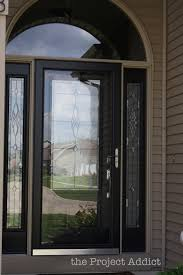 black glass front door. Glass Panel Black Front Door With Curved Transom Windows And Wooden Exterior Wall