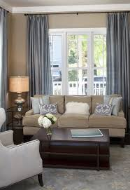 Good Tan Walls, Grey Curtains, Grey And White Area Rug, Navy, White, Grey, Tan  Patterned Accent Pillows. Bookshelf   Golds, Blues, Greenu2026
