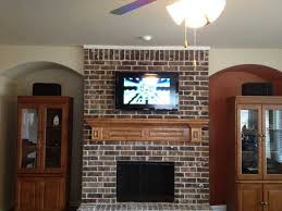 mount tv on brick fireplace luxury mounting a tv over a fireplace
