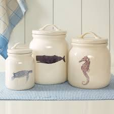 Accessories for kitchen decorating using decorative nautical seashell sea  horse white ceramic jar modern
