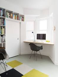 a wall desk installed in a window alcove makes the most of natural light lets you look out the window while you work
