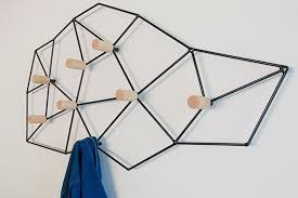 this geometric and modern wall mounted coat rack could easily pass as wall art