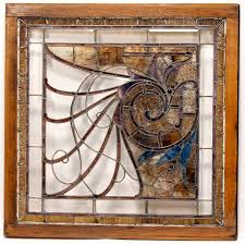 large antique leaded stained glass pub window in frame art nouveau nautilus shell motif with faceted glass jewels and beveled borde