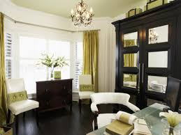 bay window ds ideas with decorative flower on wooden chest drawer padded chairs under chandelier