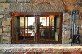 acucraft wood burning see through fireplace with aged bronze patina hammered doors