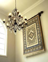 how to hang a rug wall hanging pretty tapestry hangings in entry traditional with foyer light