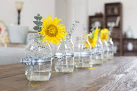 Simple And Neat Image Of Dining Room Decoration Ideas Using Yellow Flower  Centerpiece Including Unique Clear Glass Bottle Flower Vase And Rustic  Rectangular ...