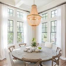 round wood dining table. Round Reclaimed Wood Dining Table With French X Back Chairs And White Slipper